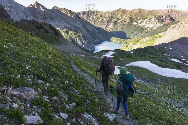 Female hikers with backpacks on mountain