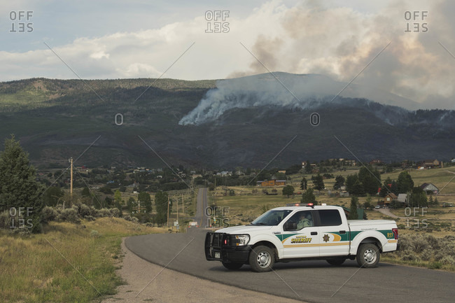 Carbondale, CO, United States - July 6, 2018: Sheriff car on road against mountain