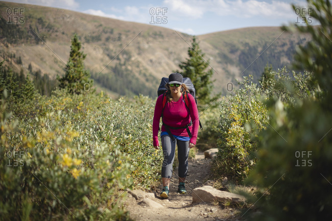 Woman hiking on mountain during summer