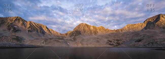 Panoramic shot of Elk Mountains against cloudy sky during sunset