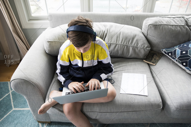 Overhead View of Tween Boy Using Laptop for Distance Learning