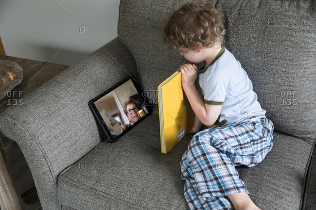 Preschool Boy Reads Book With Grandma Over Video Chat