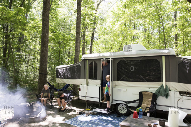 Wide View of Pop Up Camper at Campsite on Family Camping Trip