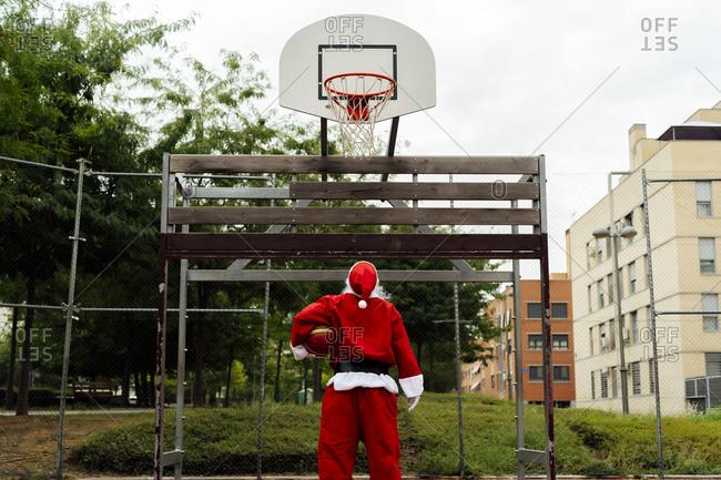 Santa Claus looking at the basketball net
