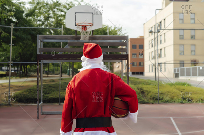 Santa Claus ready to play a basketball game