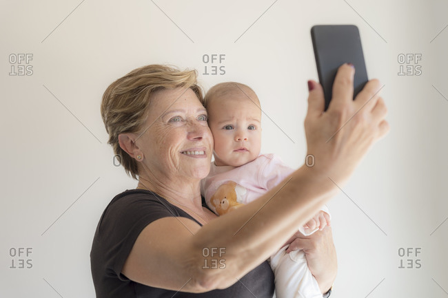 Grandmother taking a selfie with her granddaughter