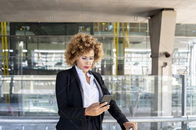 Stewardess in working uniform using her smartphone