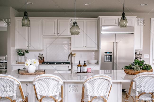 Horizontal portrait of a clean white kitchen