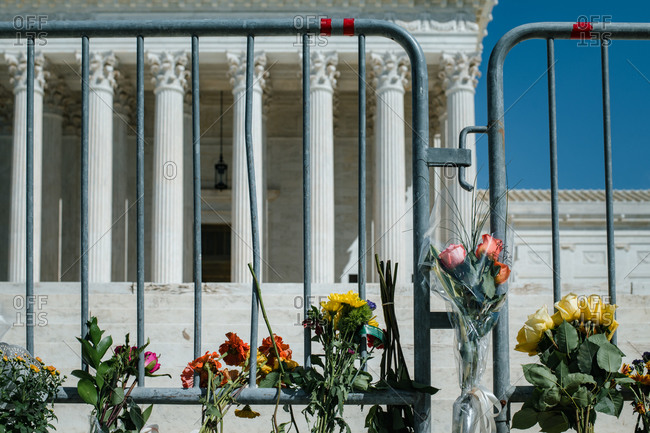 Washington, DC, United States - September 19, 2020: Flowers placed at fencing outside the Supreme Court for RBG