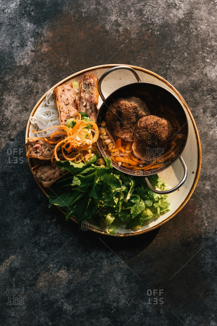 A fresh plate of traditional Vietnamese Bun cha in golden light