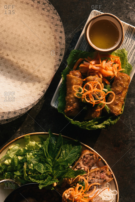 Overhead view of plate of spring rolls and other Vietnamese appetizers