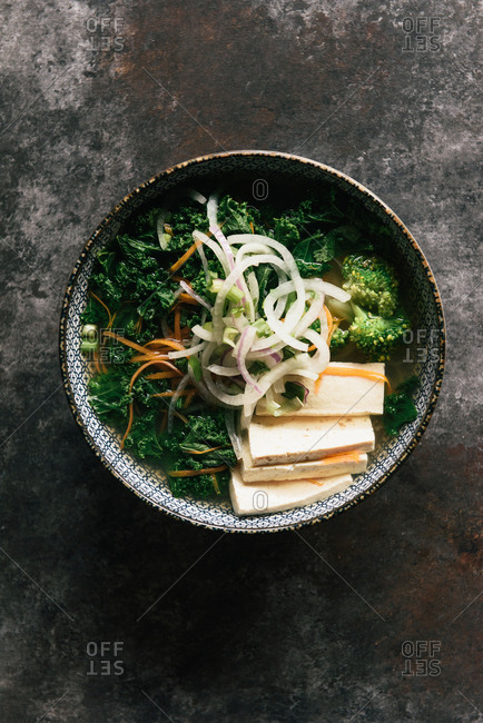 Overhead of a vegetarian bowl of Vietnamese Pho with kale and tofu