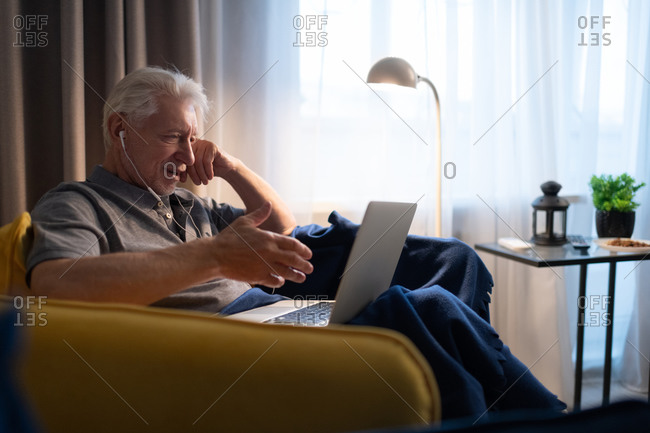Senior male speaking with family online