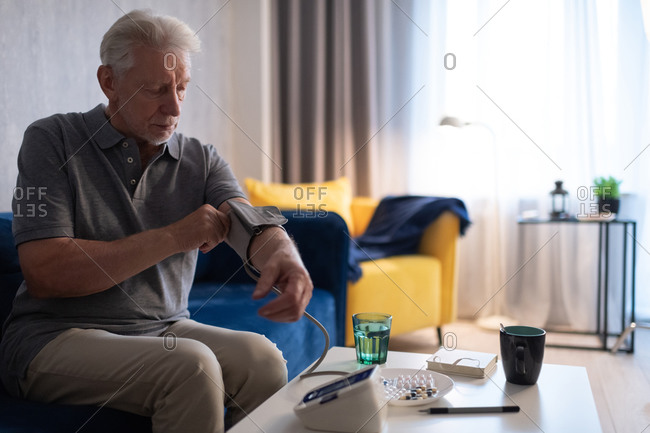 Aged man measuring blood pressure