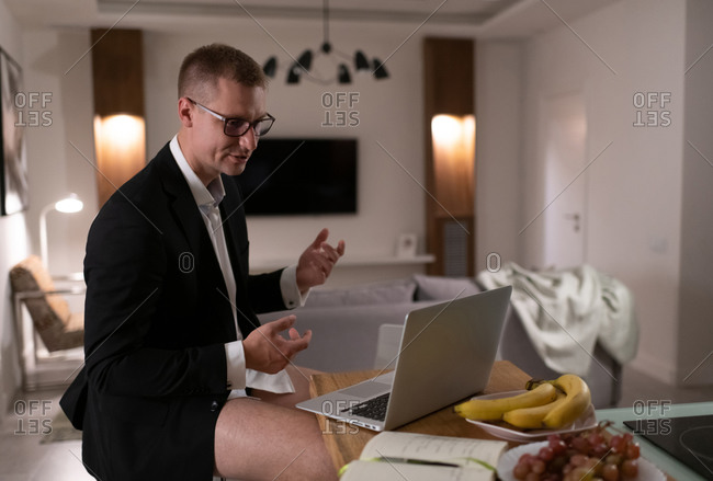 Businessman having online meeting at home