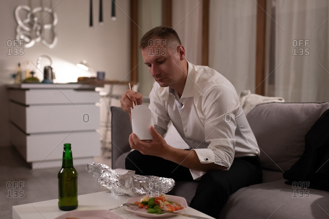 Businessman eating delivery food at home