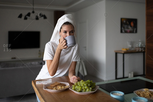 Woman drinking hot beverage after shower