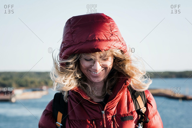 Woman standing while her hair blows in the wind
