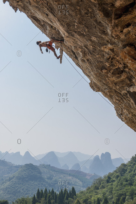 Man climbing at Odin's Den in Yangshuo, a climbing Mekka in China