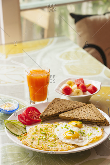 Healthy breakfast with fried eggs and fruit bowl in Yangshuo