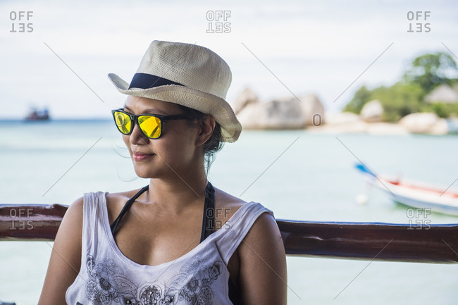 Woman relaxing on the tropical island of Koh Tao in Thailand