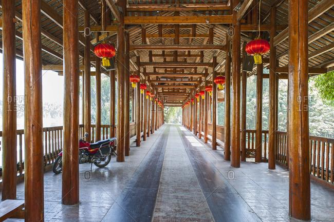 Guilin, Guangxi, China - October 16, 2015: Roofed bridge over the river Li in Yangshuo