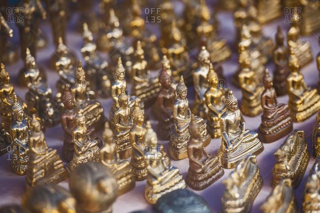Close up of Buddha statues at street market in Ayutthaya