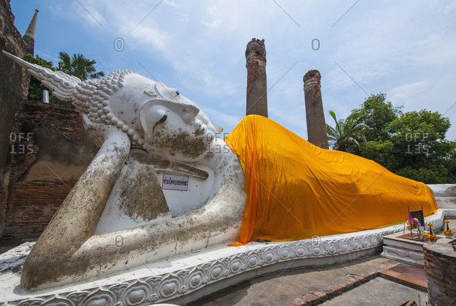 Phra Nakhon Si Ayutthaya, Thailand - June 1, 2016: Reclining Buddha statue at Wat Yai Chaimongkol in Ayutthaya