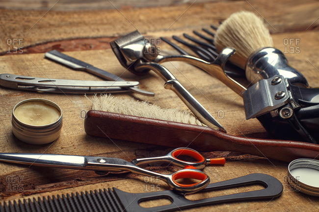 Hairdresser and barbershop props on wooden table