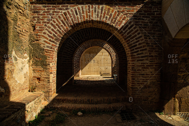 Detail of a red brick Roman arch with a play of light and shadow