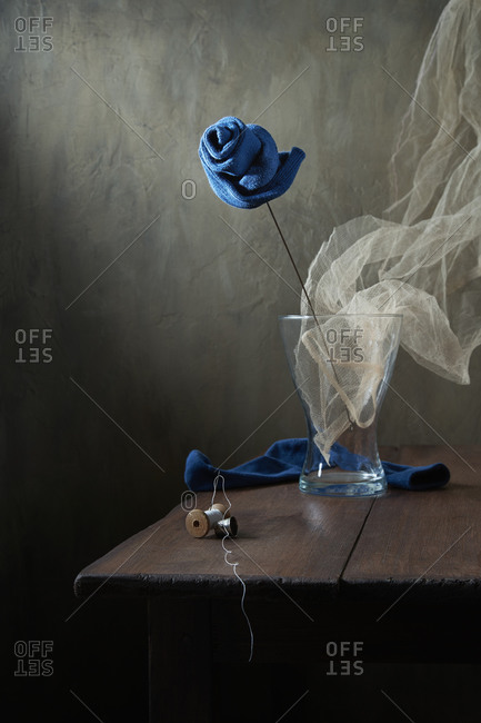 Still life with a blue rose made from socks