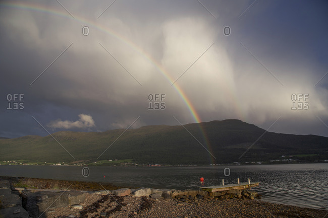 A double rainbow of a fjord in Norway