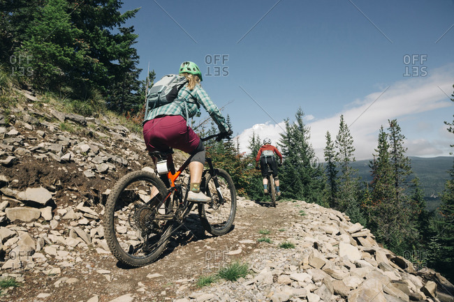 Two female bikers ride on a trail at Timberline Bike Park in Oregon.