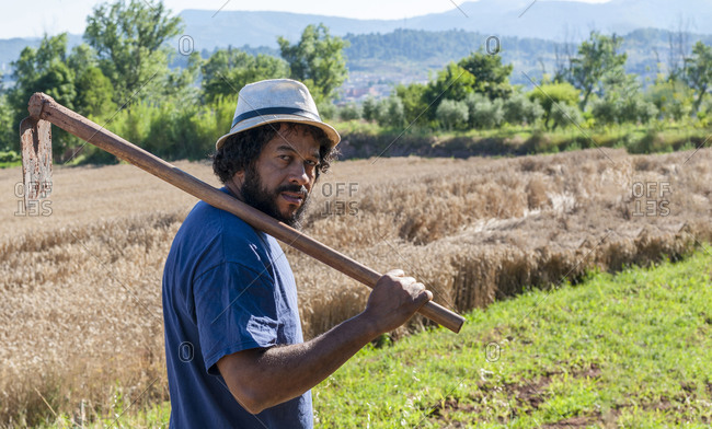 Colombian portrait with an orchard tool, copy space.