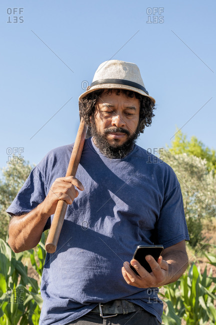 Colombian man looking at the phone