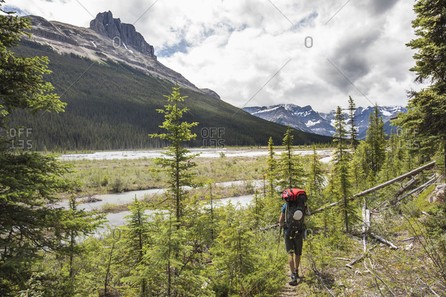 Backpacker hiking towards Castle guard Meadows, Banff National Park.