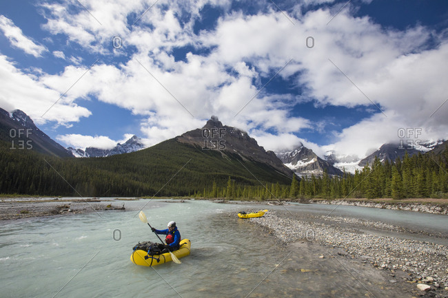 Man exploring the Alexandra River by inflatable packraft, hike, paddle