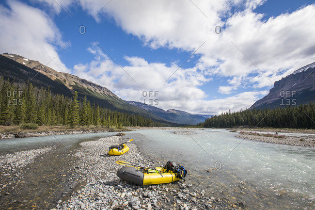 Scenic view of two packrafts on river bank in Banff National Park.