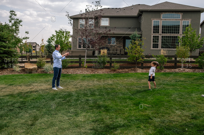 Father and Son playing catch in the backyard