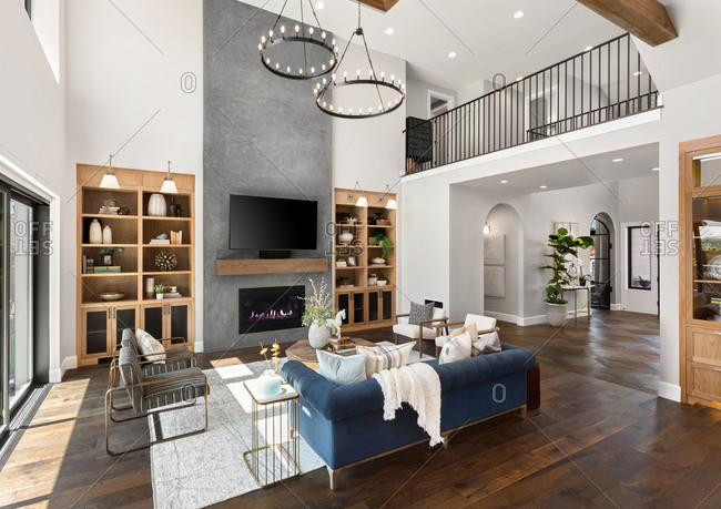 Living room in new luxury home with floor to ceiling fireplace s
