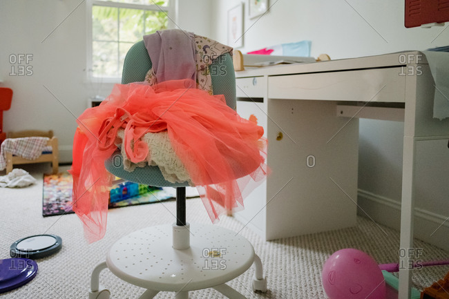 Messy desk and floor in child's room