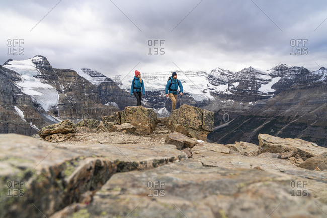 Couple Summiting Mount Fairview In Front of Victoria Glacier