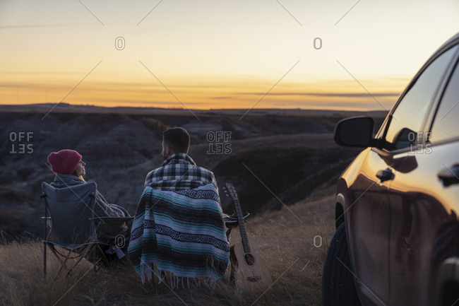 Couple Watching the Sun Fade To Over Horseshoe Canyon