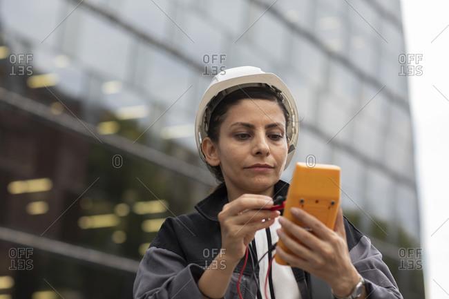 Female  engineer with helmet working outside