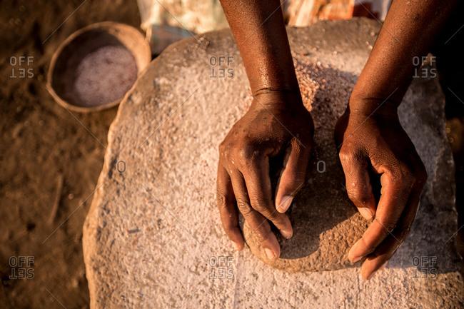 Close-up of a woman preparing grain, Zimbabwe