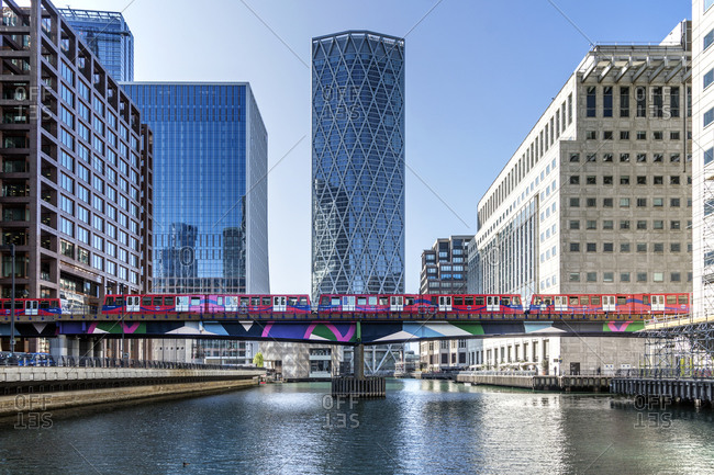 September 18, 2020: Dockland Light Railway (DLR) train crossing Middle Dock at Canary Wharf, Docklands, London, England, United Kingdom, Europe