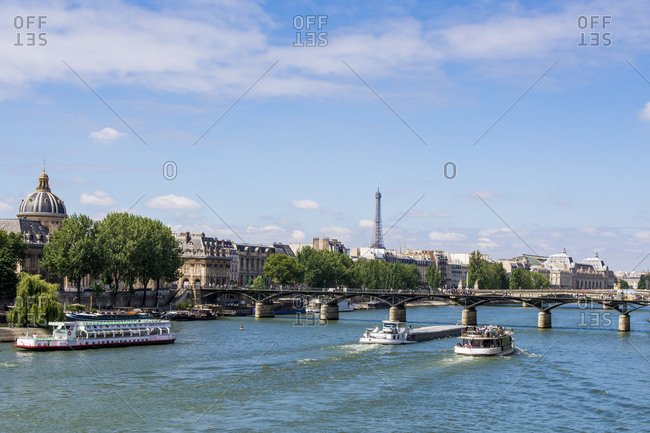 July 16, 2016: Pont Neuf Bridge over the River Seine with the Eiffel Tower behind, Paris, France, Europe