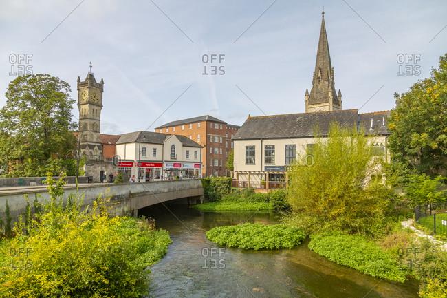 View of River Avon and ornate clock tower on Fisherton's Street, Salisbury, Wiltshire, England, United Kingdom, Europe