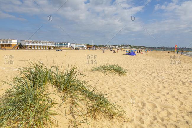 View of beach huts overlooking Sandbanks Beach in Poole Bay, Poole, Dorset, England, United Kingdom, Europe