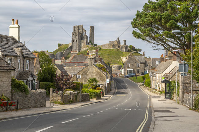 View of cottages on East Street and Corfe Castle, Corfe, Dorset, England, United Kingdom, Europe